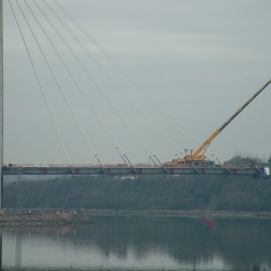 200 ton liebherr working on a new cable suspended bridge