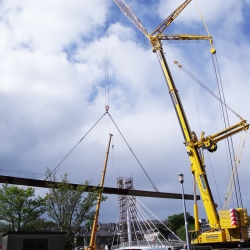 terex demag ac 350 with main boom and luffing fly jib lifting a steel bridge beam