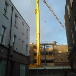 Spiering Mobile self erect tower crane working i